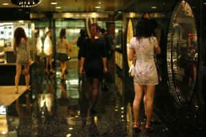 Prostitutes from mainland China wait for customers inside the shopping mall of a hotel in Macau